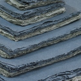 Grey shades of Khadi paper in various sizes.