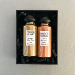 Set of two London Pigments in black presentation box.