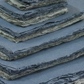 Grey shades of Khadi paper in various sizes.